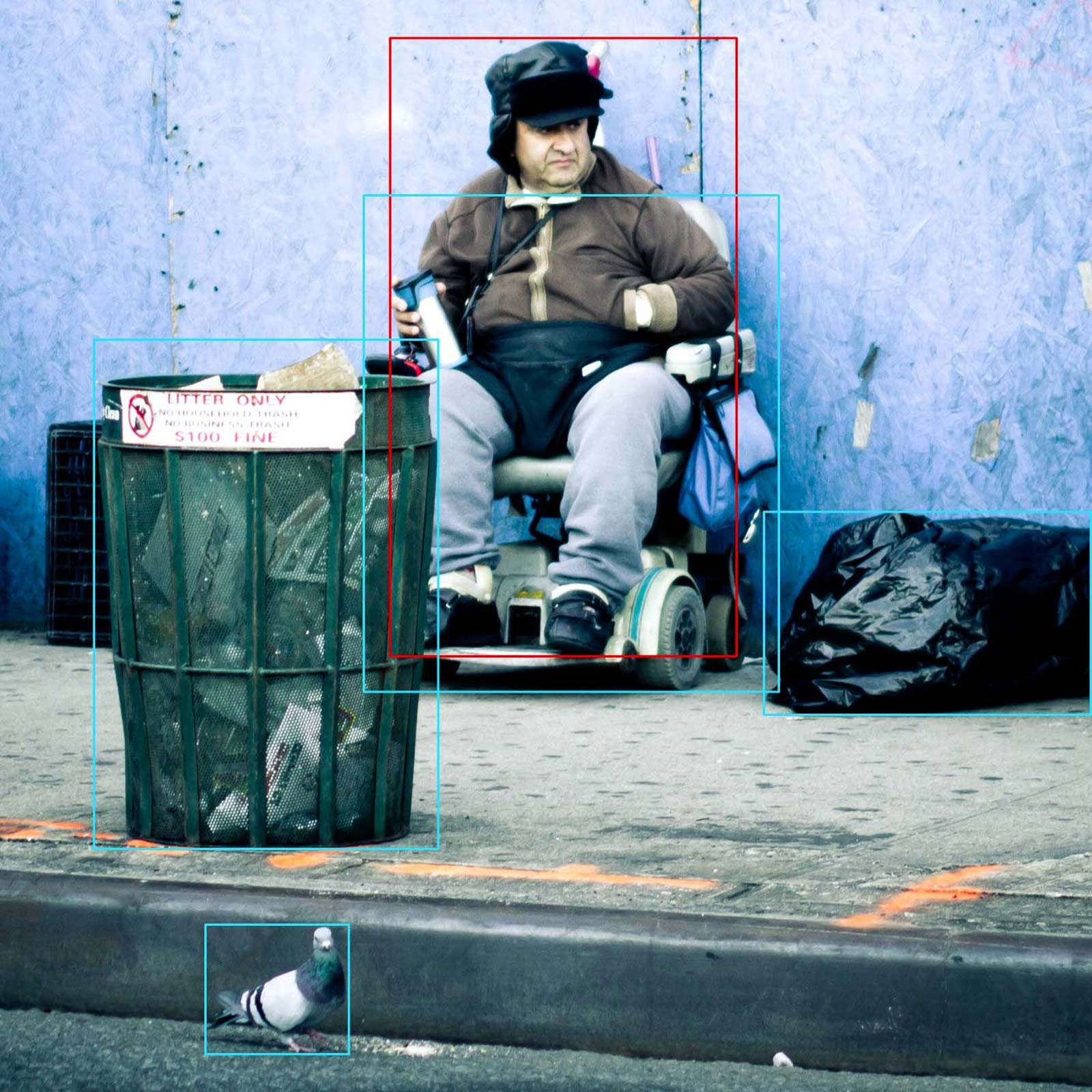 A man in a wheelchair, annotated image with wrong classification